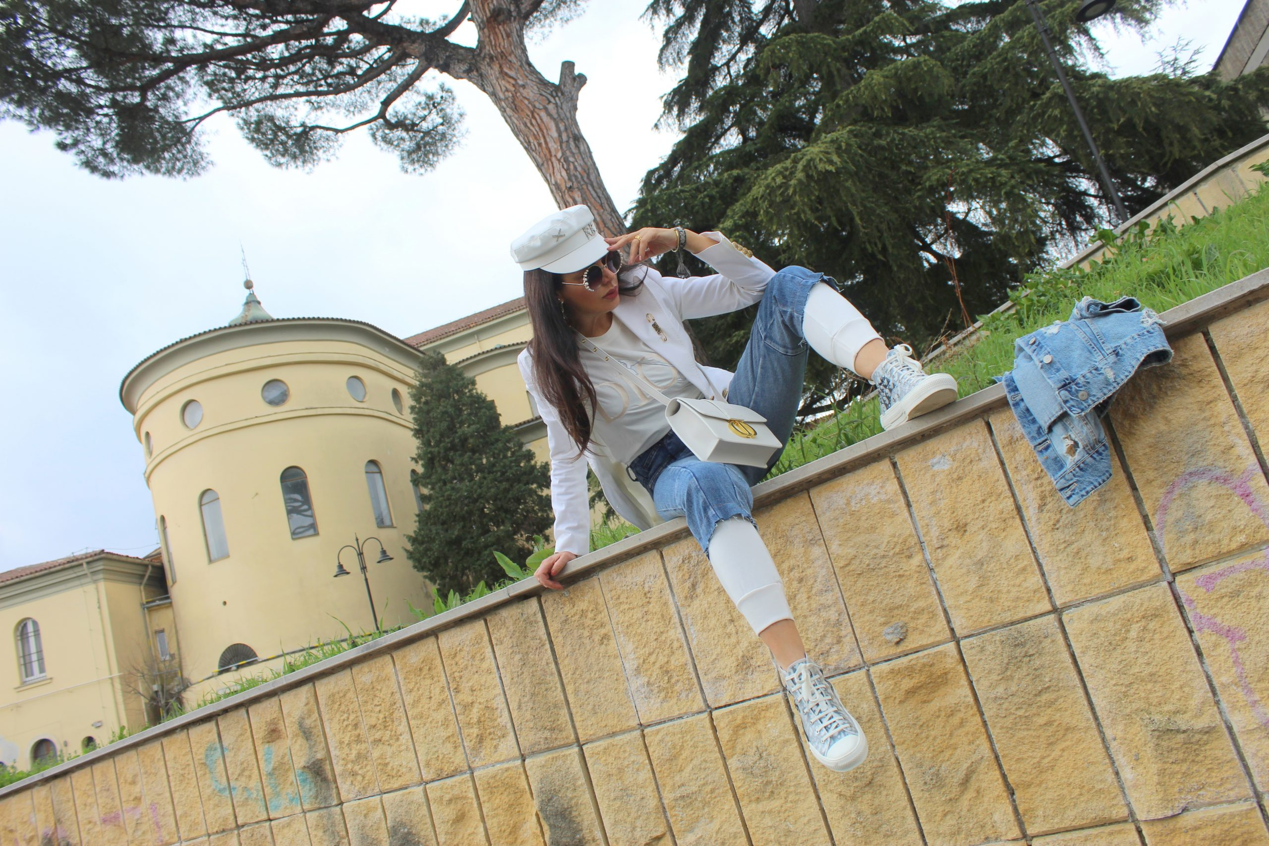 Joggers white and jeans combo Dior accessories gold details Spring Trend Paola Lauretano