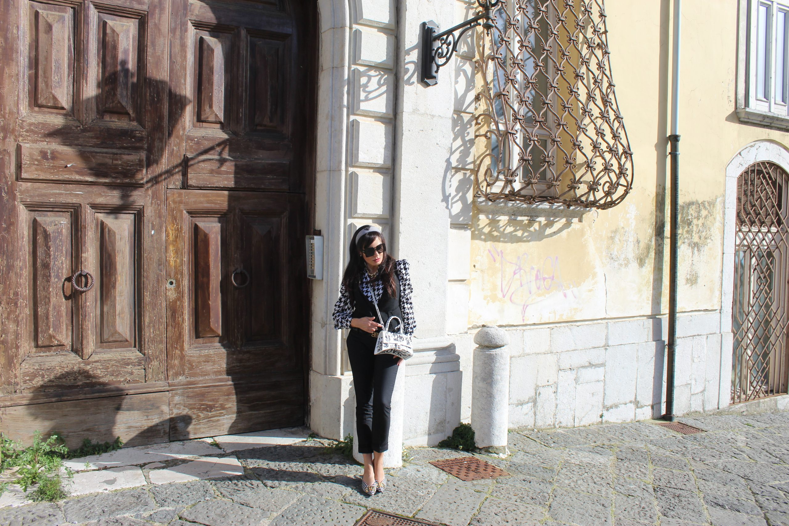 animalier fabric prints black and white outfit Prada accessories